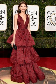 zendaya stuns at 2016 golden globes in plunging oxblood deep red prom celebrity red carpet gown